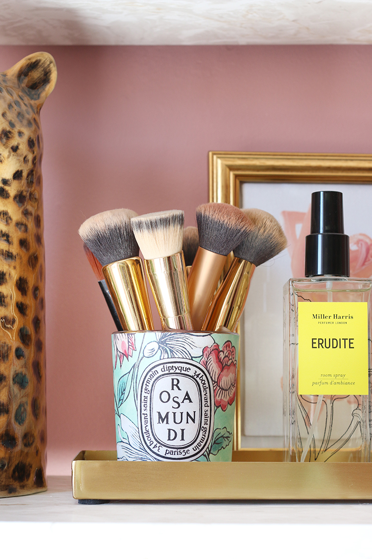 Used Diptyque candle for holding makeup brushes
