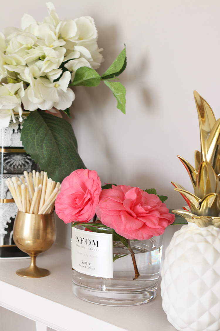 Old Neom candle container as a vase