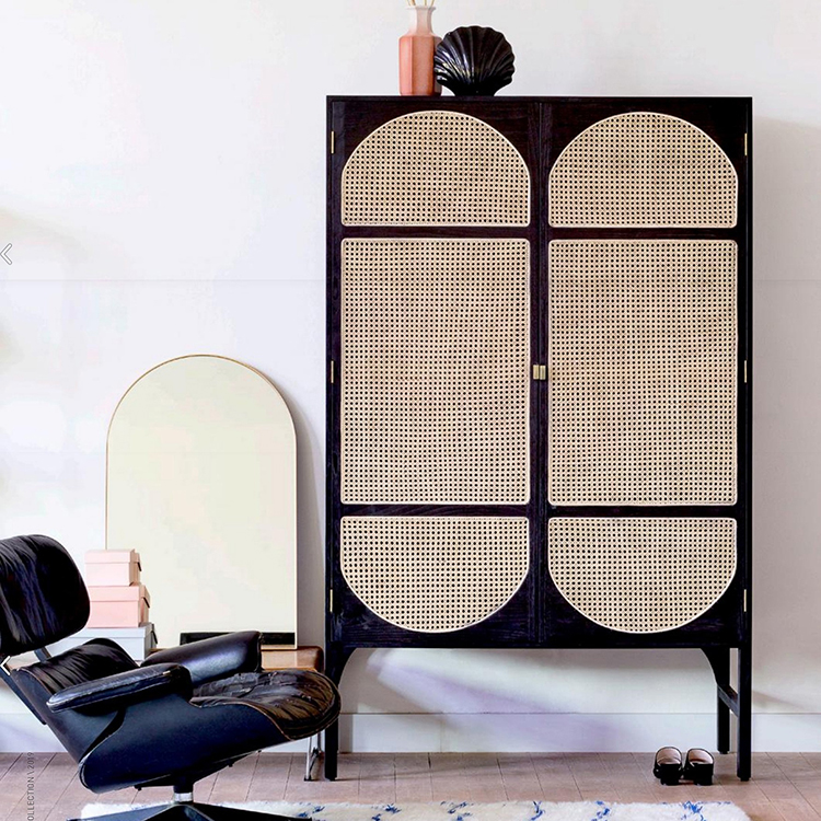 Woven cabinet in black with cane rattan doors