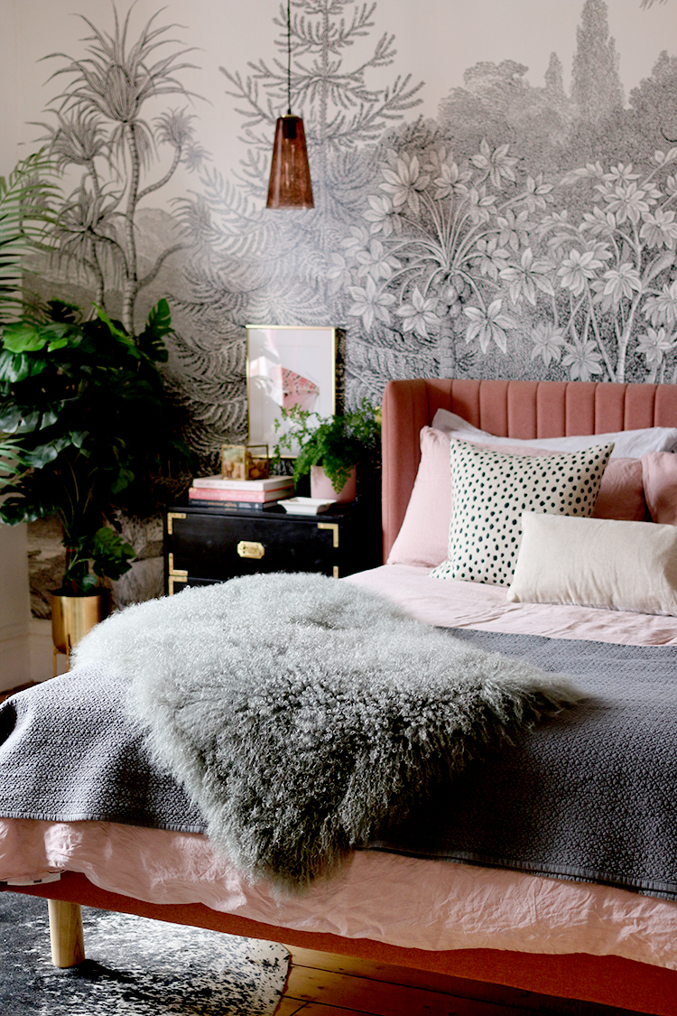 pink grey and black bedroom with wall mural