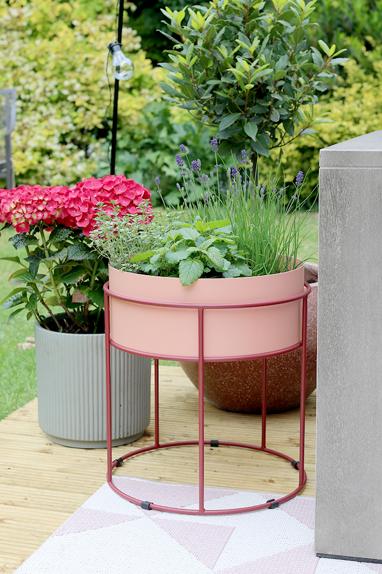 garden planters in pink and green on deck