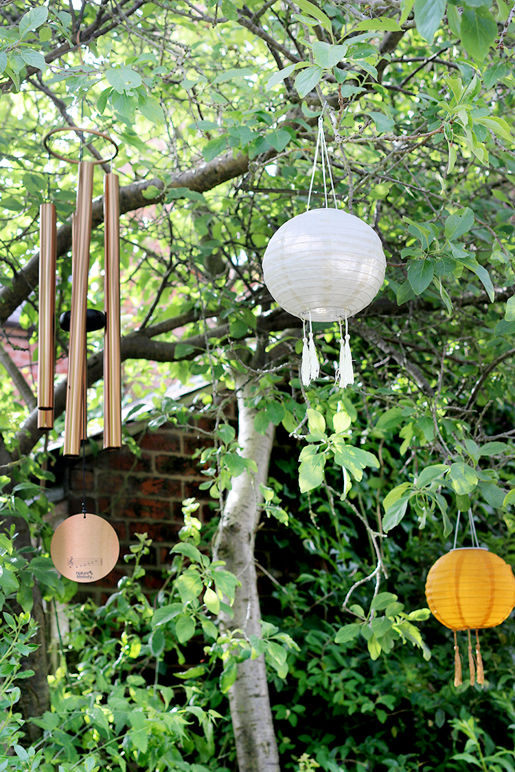 solar lights and windchime in tree