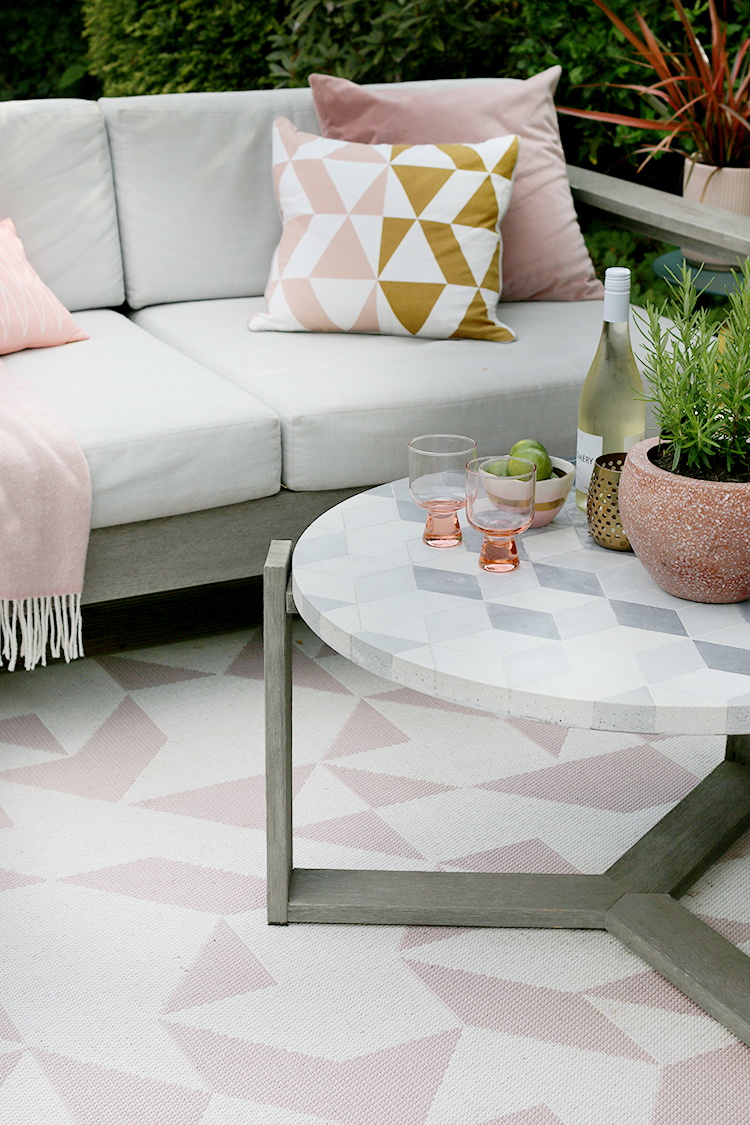 geometric patterns in pink grey and gold outside living room