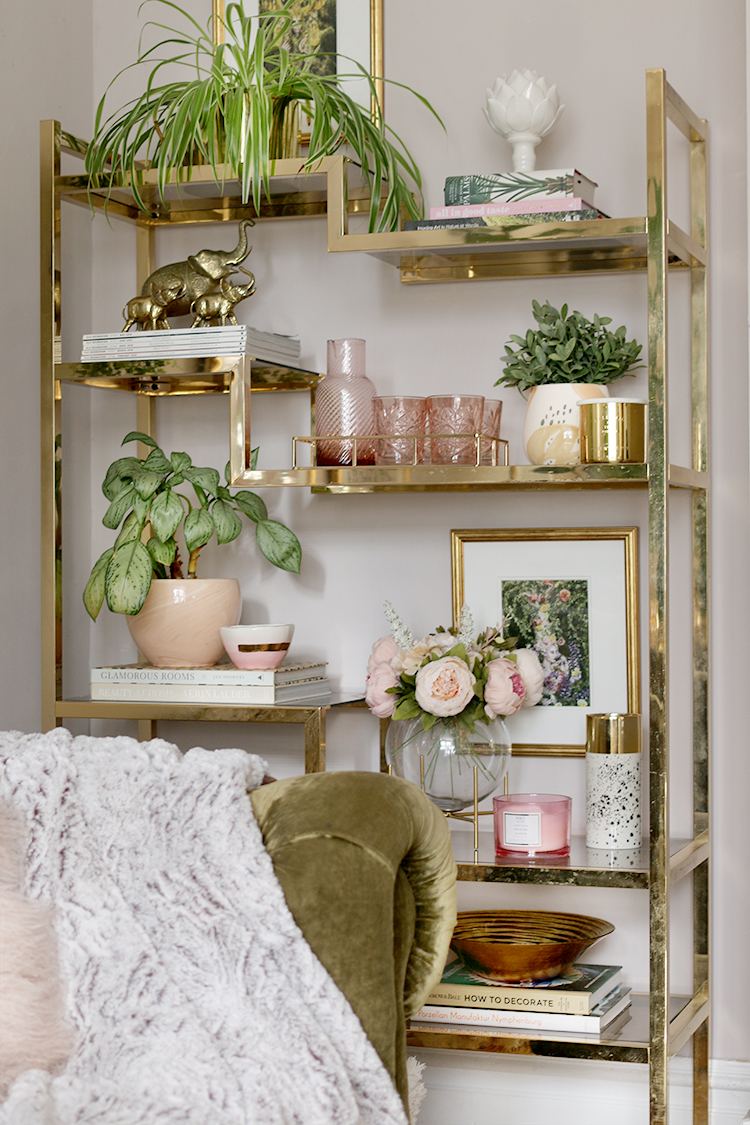 Introducing the Finishing Touch Styling Service - gold vintage shelf styled with pink and gold accents and plants
