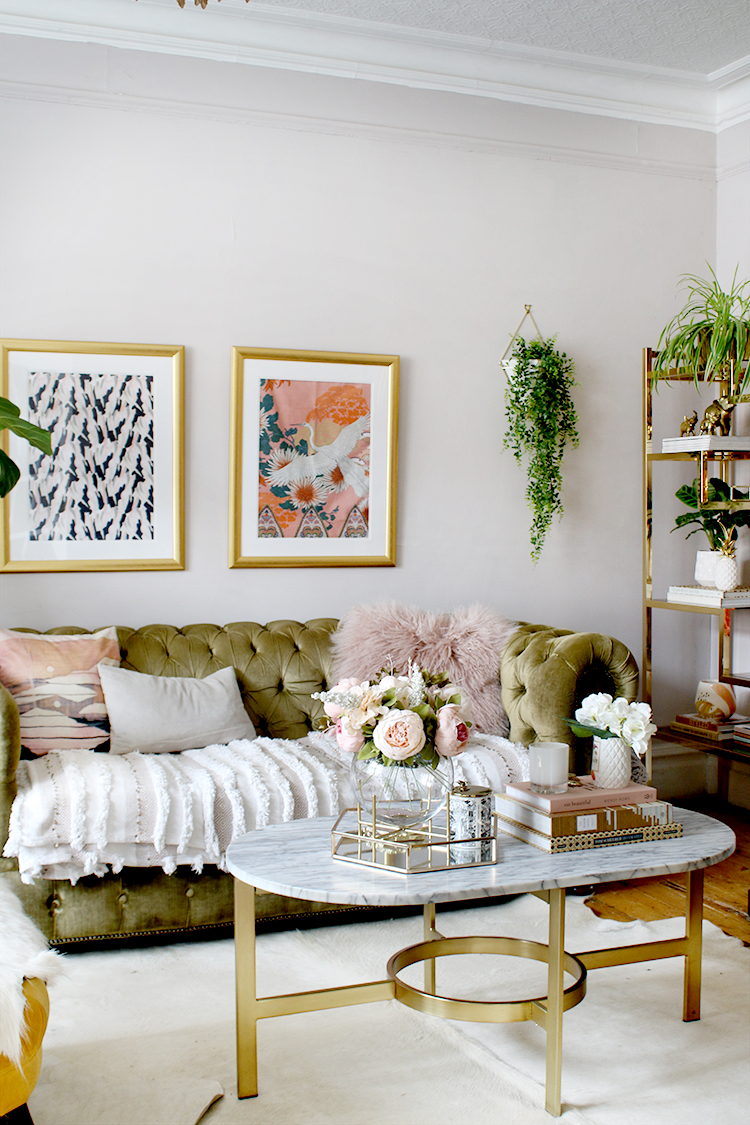 olive green velvet sofa in boho glam living room