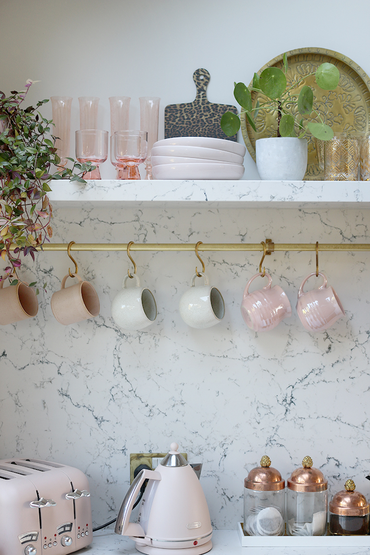 kitchen shelf with marble effect backsplash and shelf - kitchen styling in pink