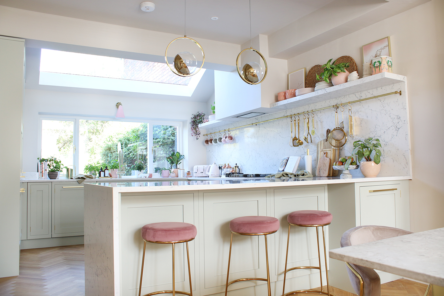 kitchen reveal in pale green with gold and pink accents