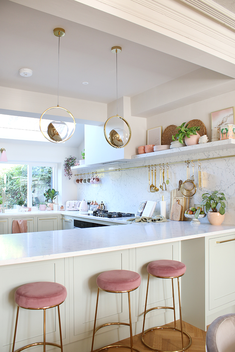 breakfast bar - Pale green kitchen with parquet flooring and gold and pink accents