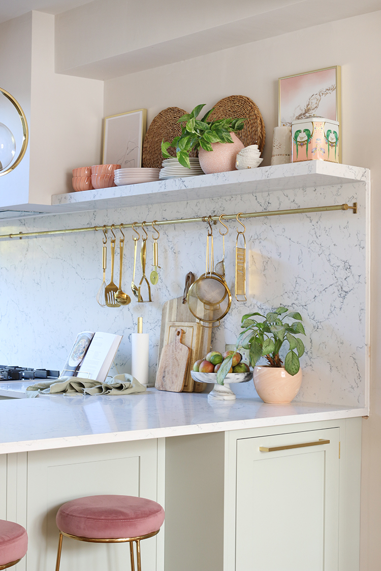 kitchen open shelving styled in green, pink and gold accents