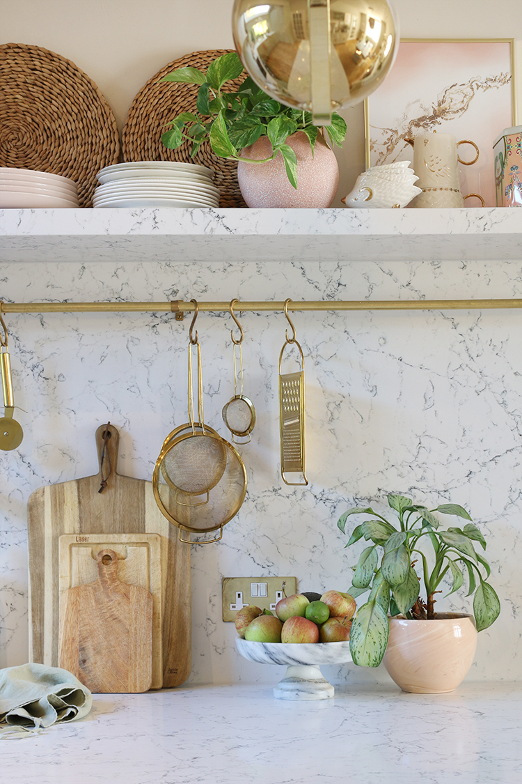 kitchen shelving with marble effect quartz worktops and shelf