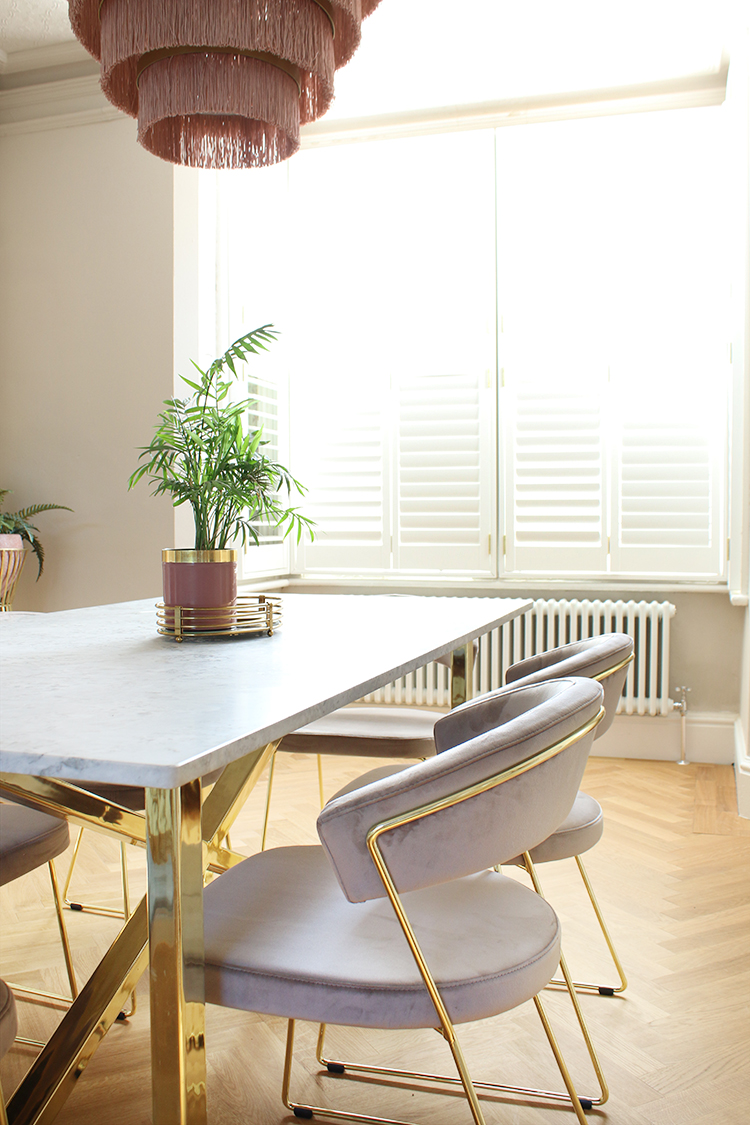 dining room with shutters in bay window and vintage style radiator