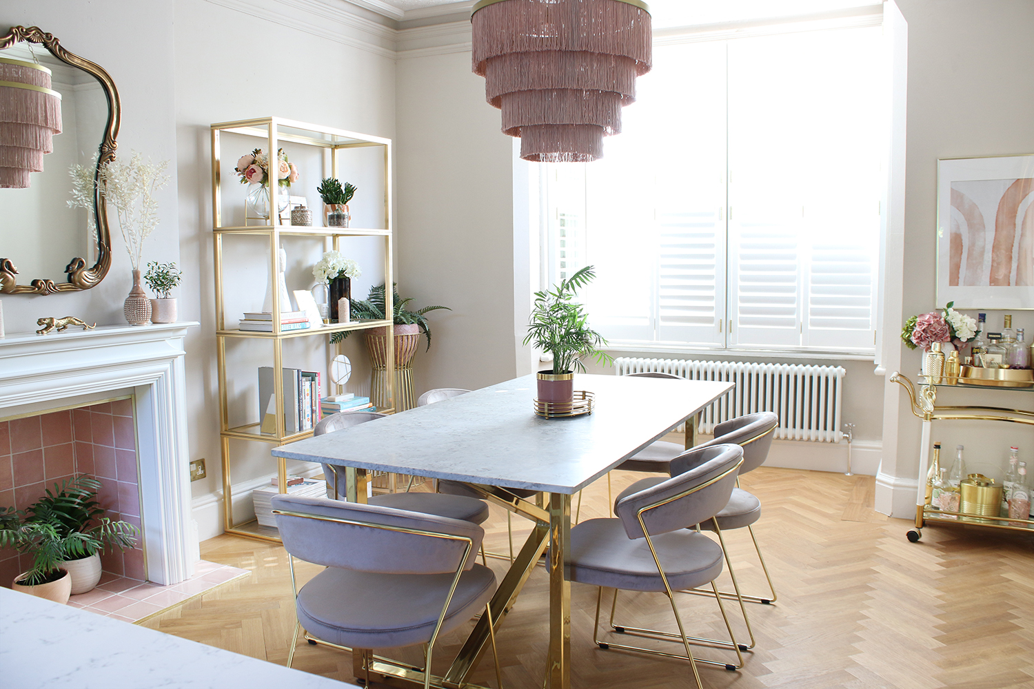 dining room with parquet flooring in taupe and pink with marble table
