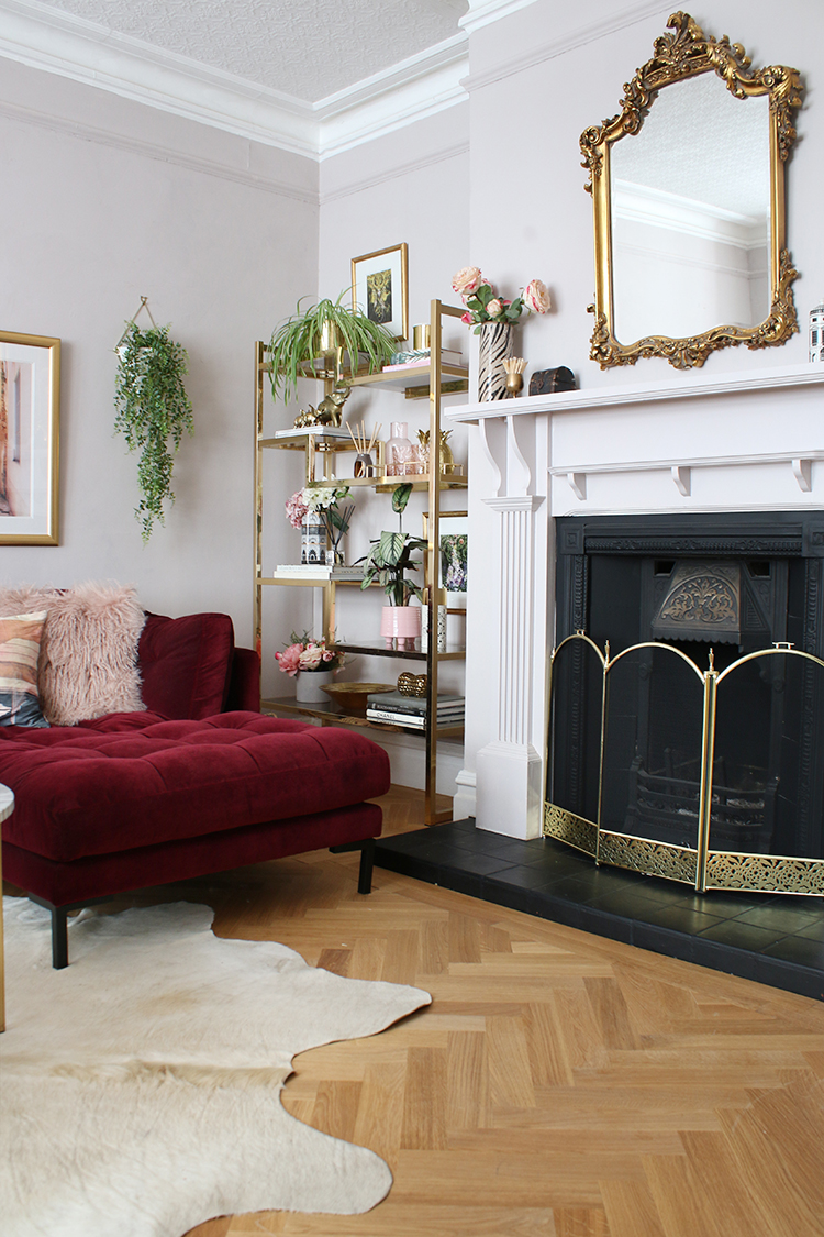 fireplace in victorian living room with parquet floor and brass accents