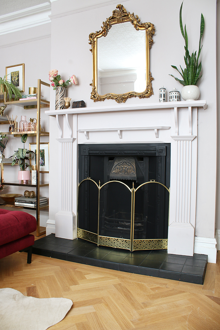 victorian fire place with ornate mirror and parquet flooring