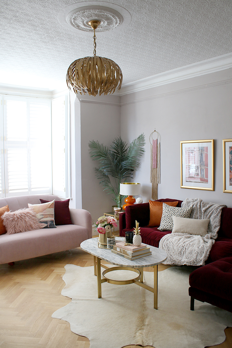 living room with pink and burgundy sofas and parquet flooring Victorian home