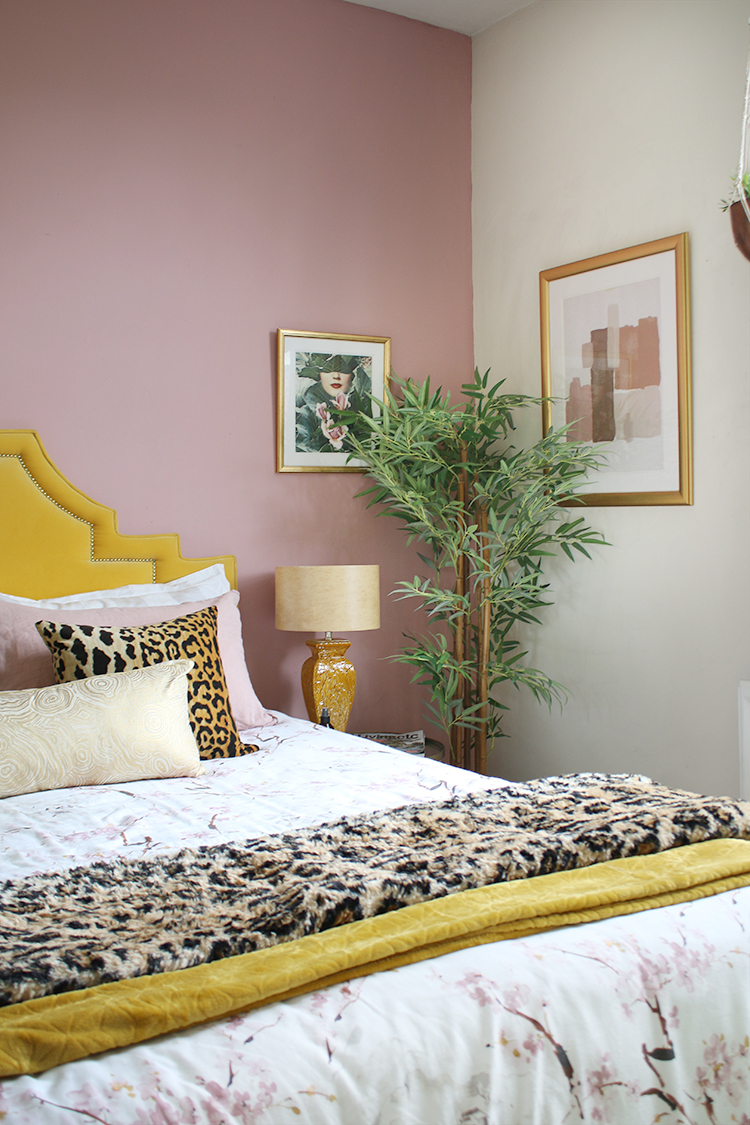 pink bedroom with vintage mustard lampshade and velvet yellow bed
