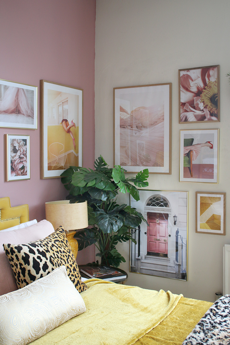 Gallery wall in pink and yellow in guest bedroom