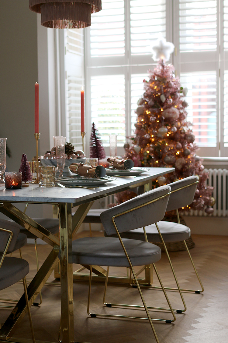 dining room with pink christmas tree