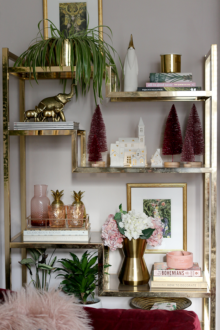 vintage brass shelving unit decorated for Christmas