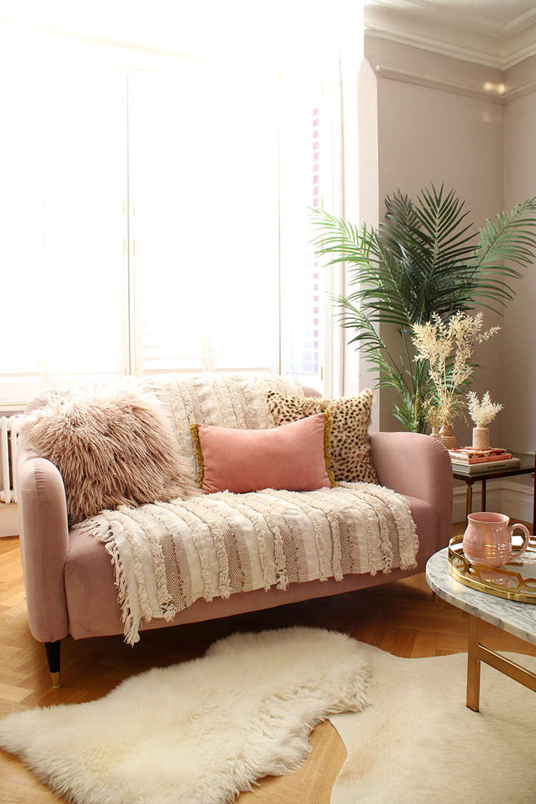 Bohemian Maximalist - layering textures to style a small sofa