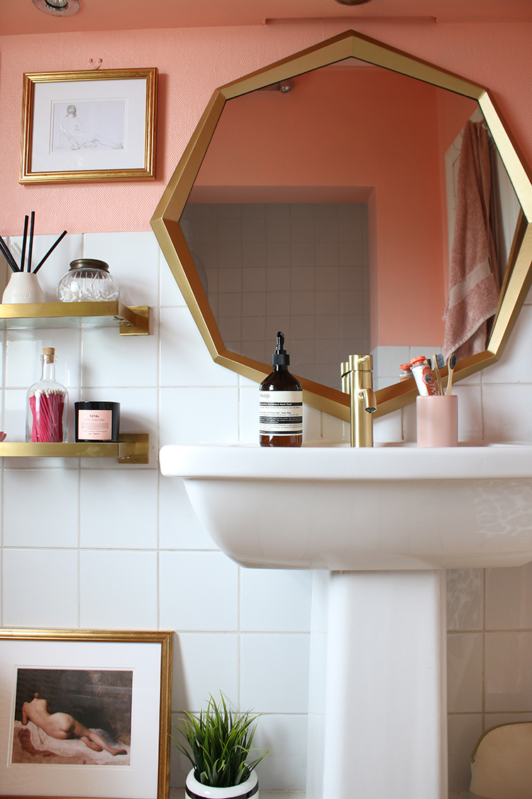 peach bathroom with gold tap and octagon mirror