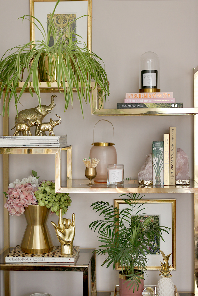 vintage gold shelf styled with plants and books