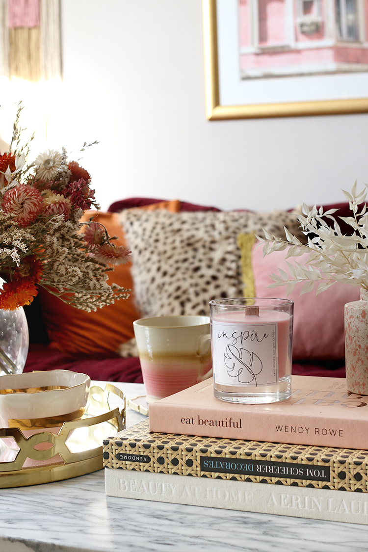 DIY Wood Wick Pink Candle on coffee table in styled living room
