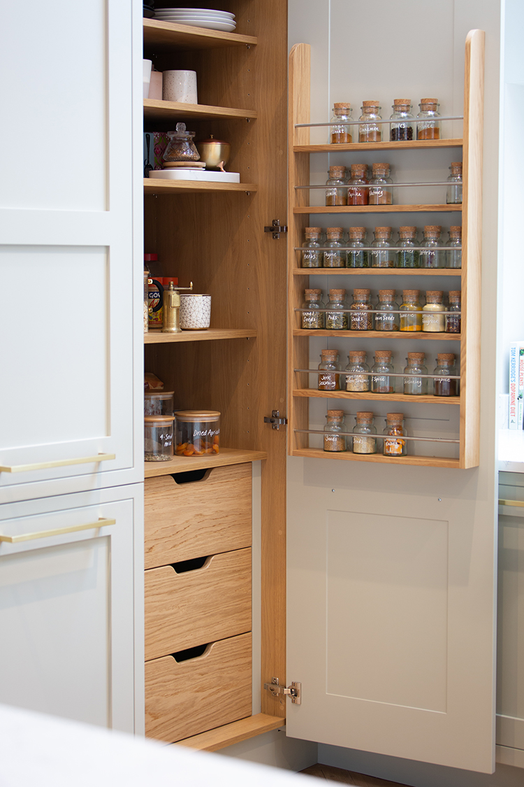 open pantry with spice rack and drawers