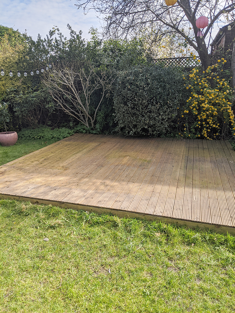Plain deck laid on lawn before
