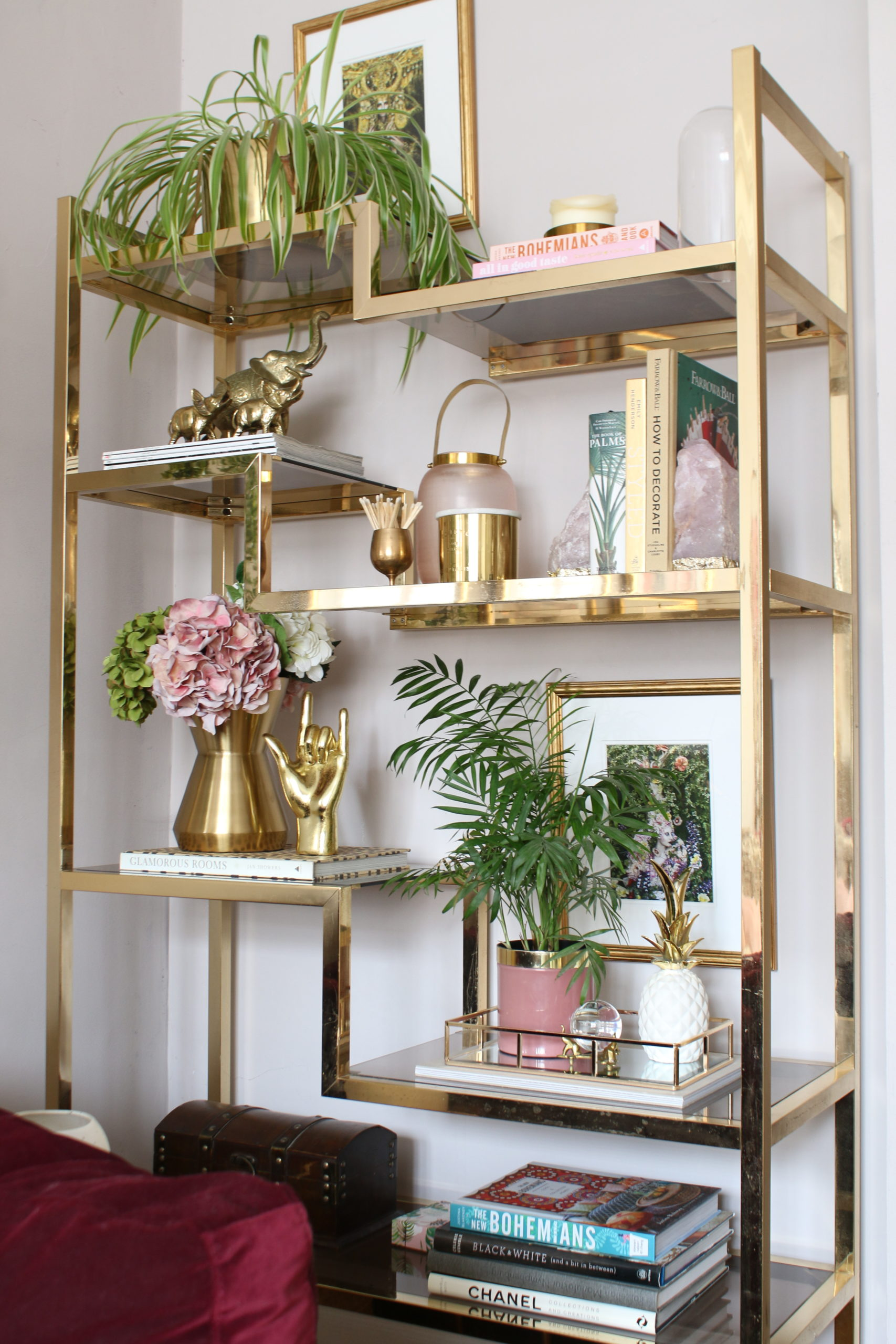 vintage brass shelving unit styled in pink and gold
