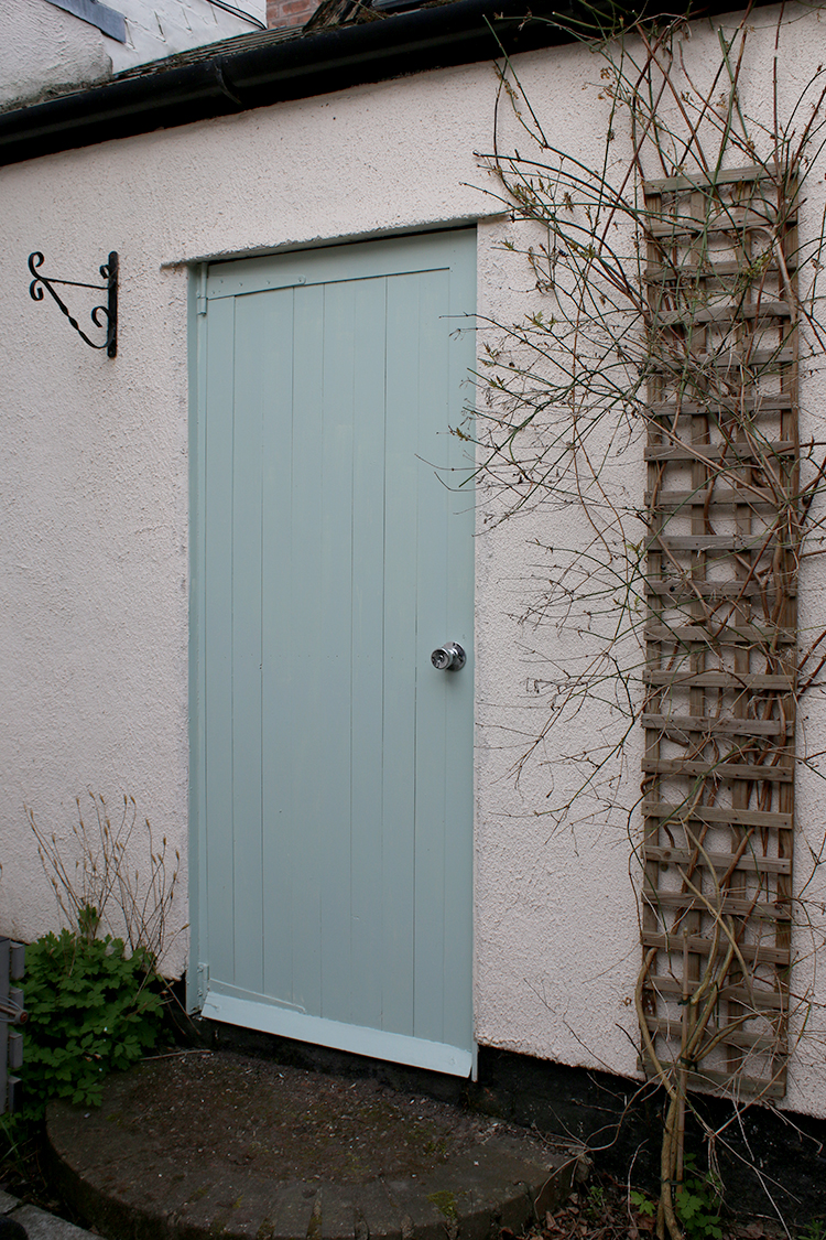 door painted sage minty green