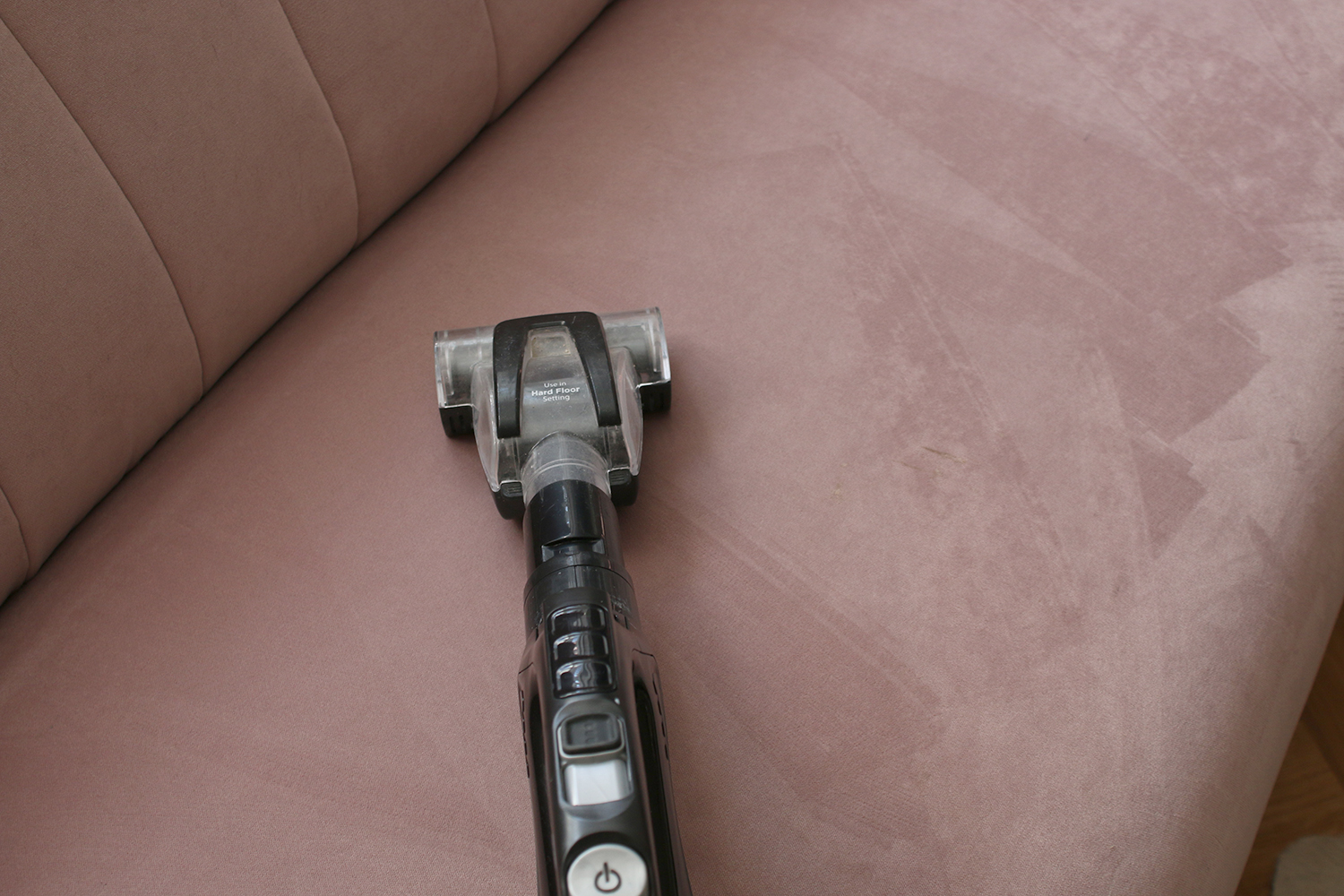 cleaning dirty sofa with small brush vacuum attachment