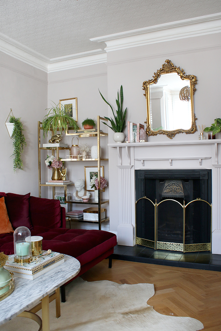 living room in Victorian home with elegant fire place and parquet floors