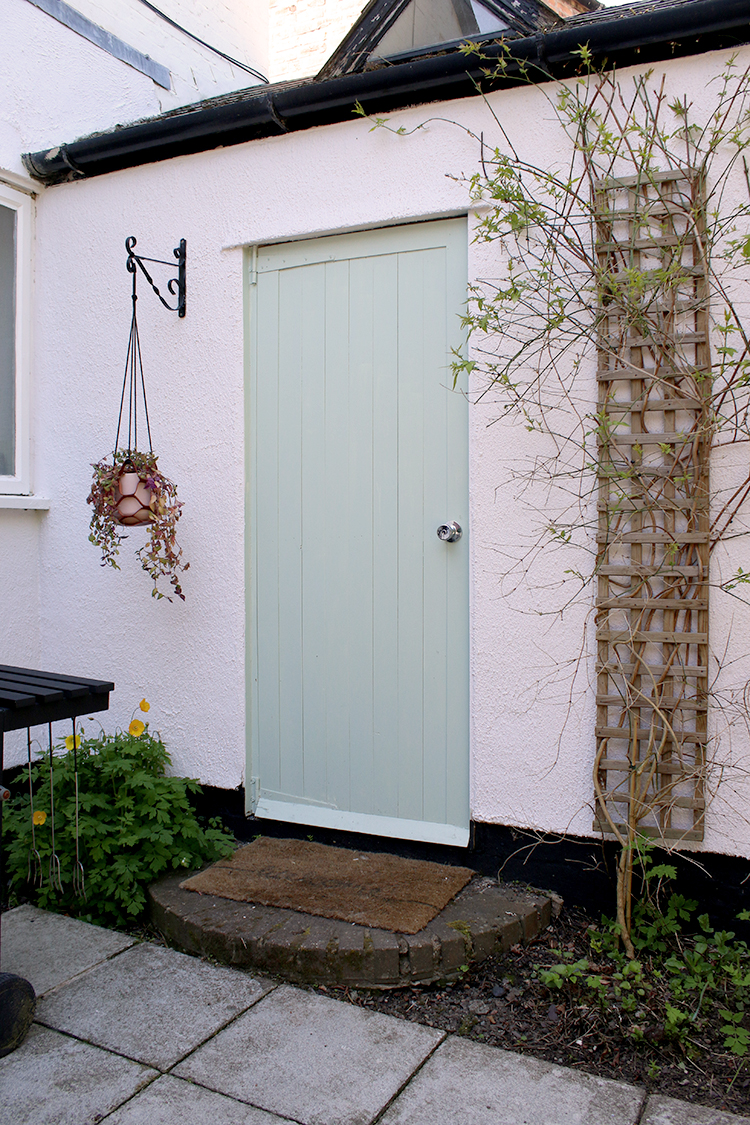 pale green door to outhouse - makeover