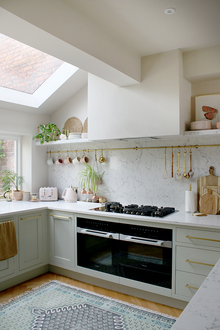 pale green kitchen with boxed in extractor