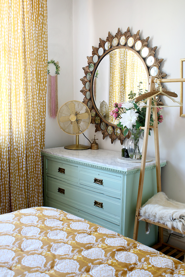 mint green chest of drawers in corner of bedroom with ornate mirror