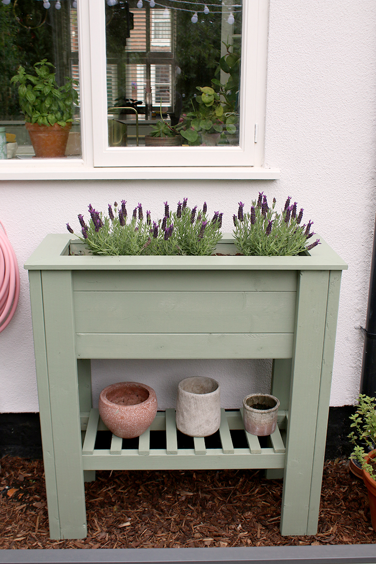 green standing waist-height planter with shelf DIY