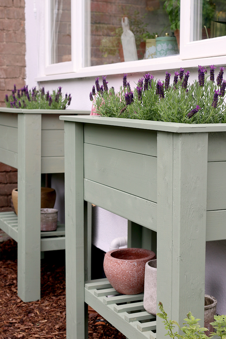 pair of sage green DIY raised planters