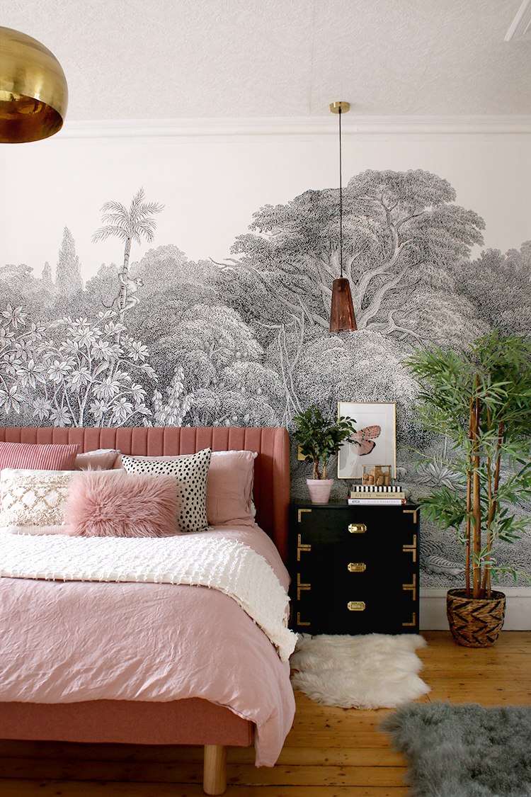 black and white wall mural in bedroom with pink bed