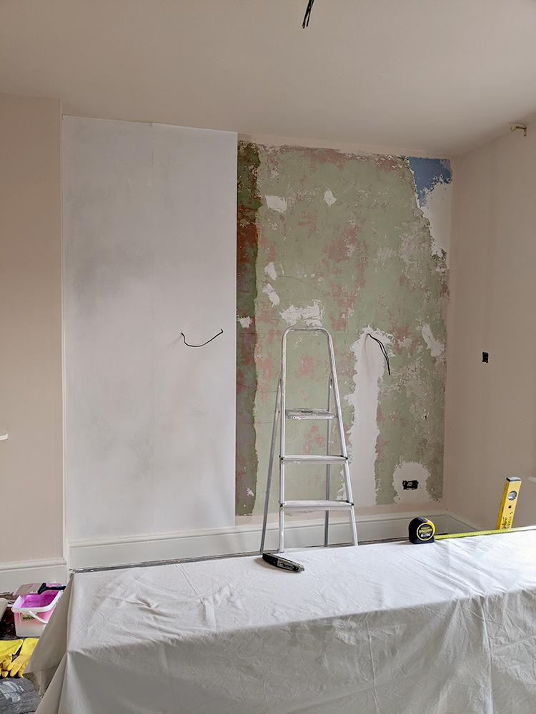 installing lining paper on plaster walls