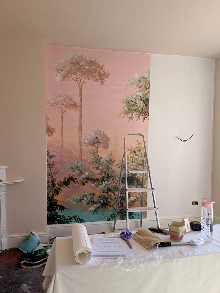 hanging wall mural in peach office