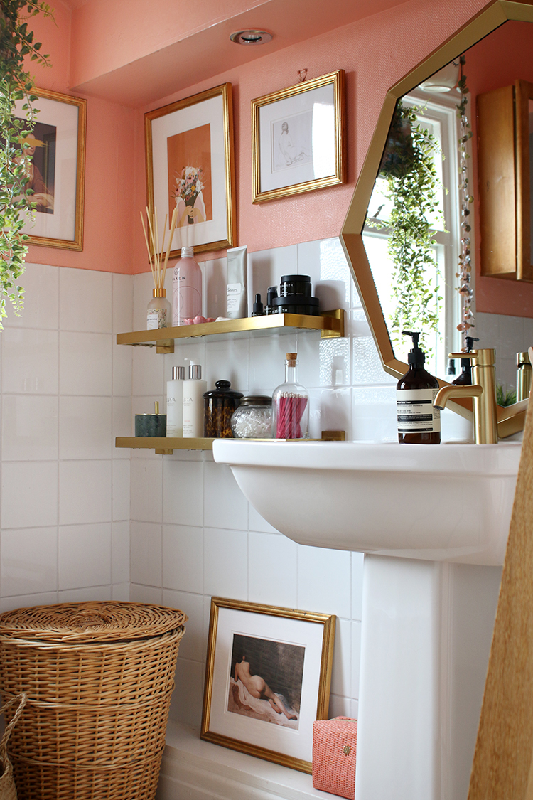 peach bathroom with gold accents