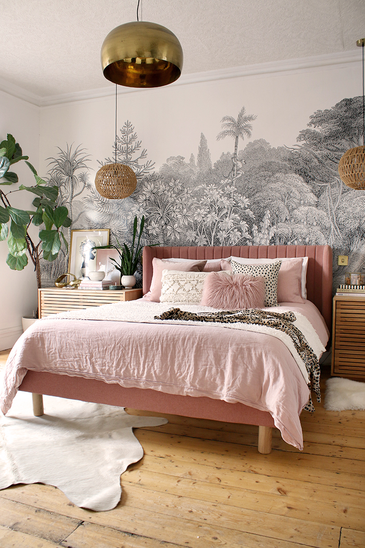 bedroom with pink bed and bohemian accents