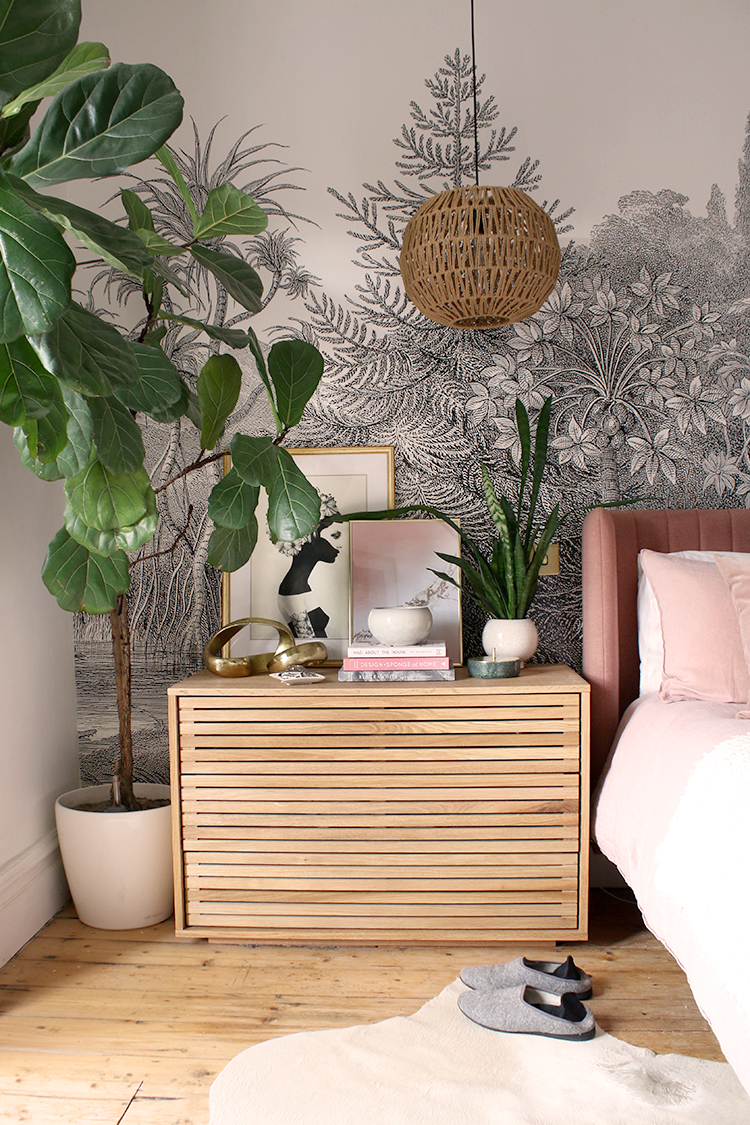large wood chest of drawers in bedroom alongside large fiddle leaf fig