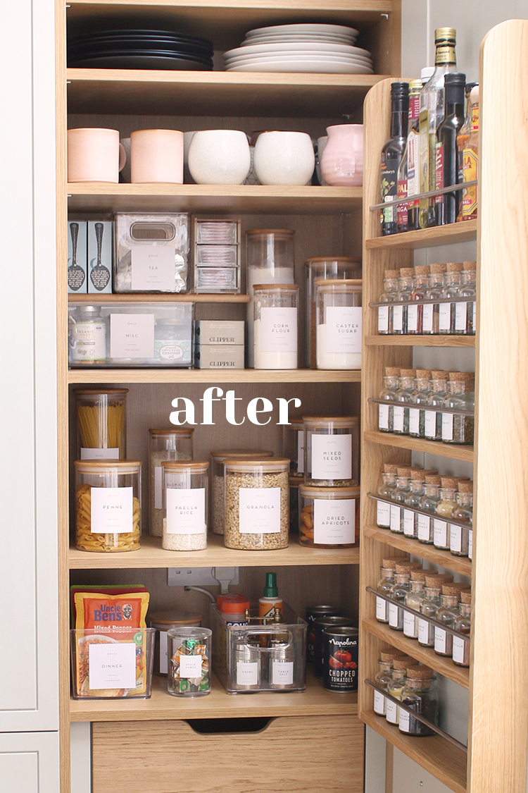 close up of pantry with door open with labelled bottles, jars and containers
