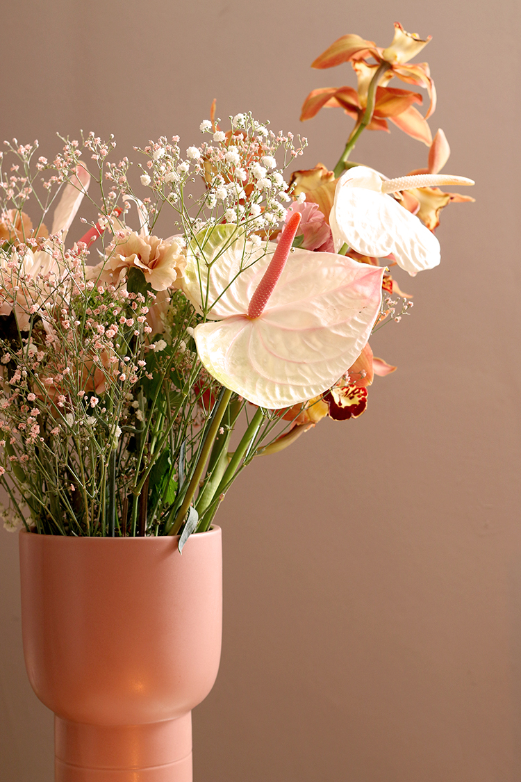 closeup of bouquet with anthurium in pink vase