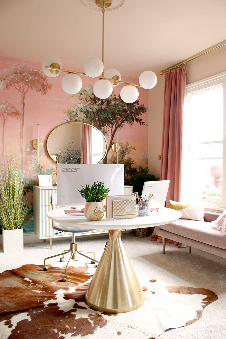 pink and peach office with round desk in middle of room