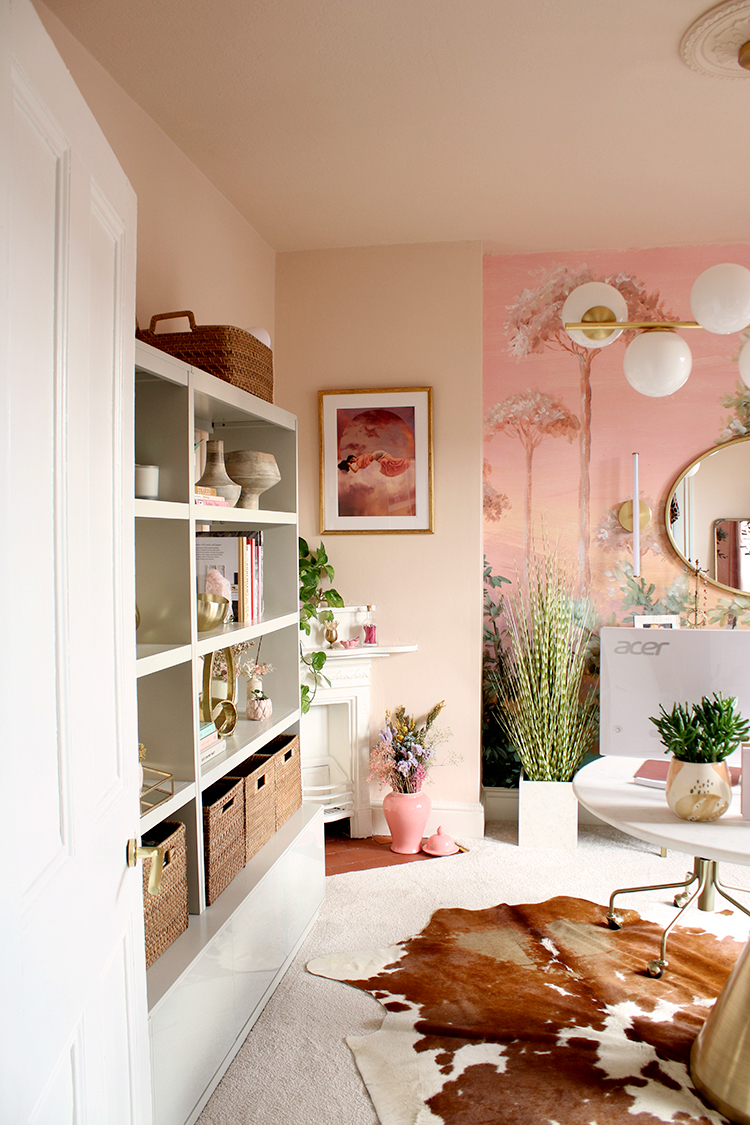 peach office with large shelving unit and corner fireplace