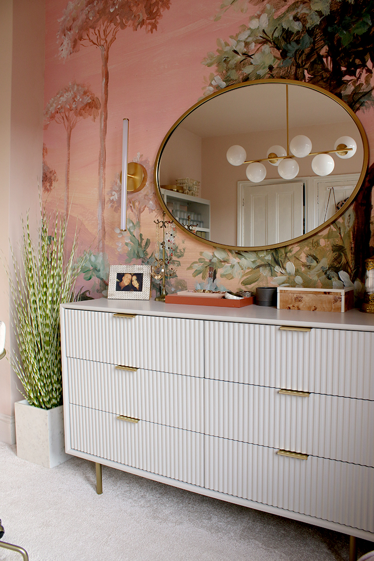 Quinn chest of drawers from West Elm against pink wall mural with oval mirror