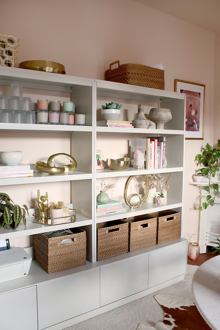 shelving unit styled with baskets books and decorative pieces